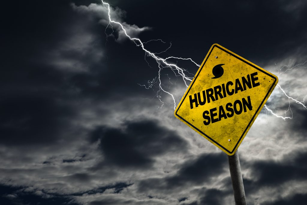 2020 Atlantic Hurricane Season. Image of sign with Hurricane Season on it with lightning striking in the background.