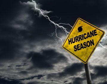 2020 Atlantic Hurricane Season. Image of sign with Hurricane Season on it with lightning striking in the background.